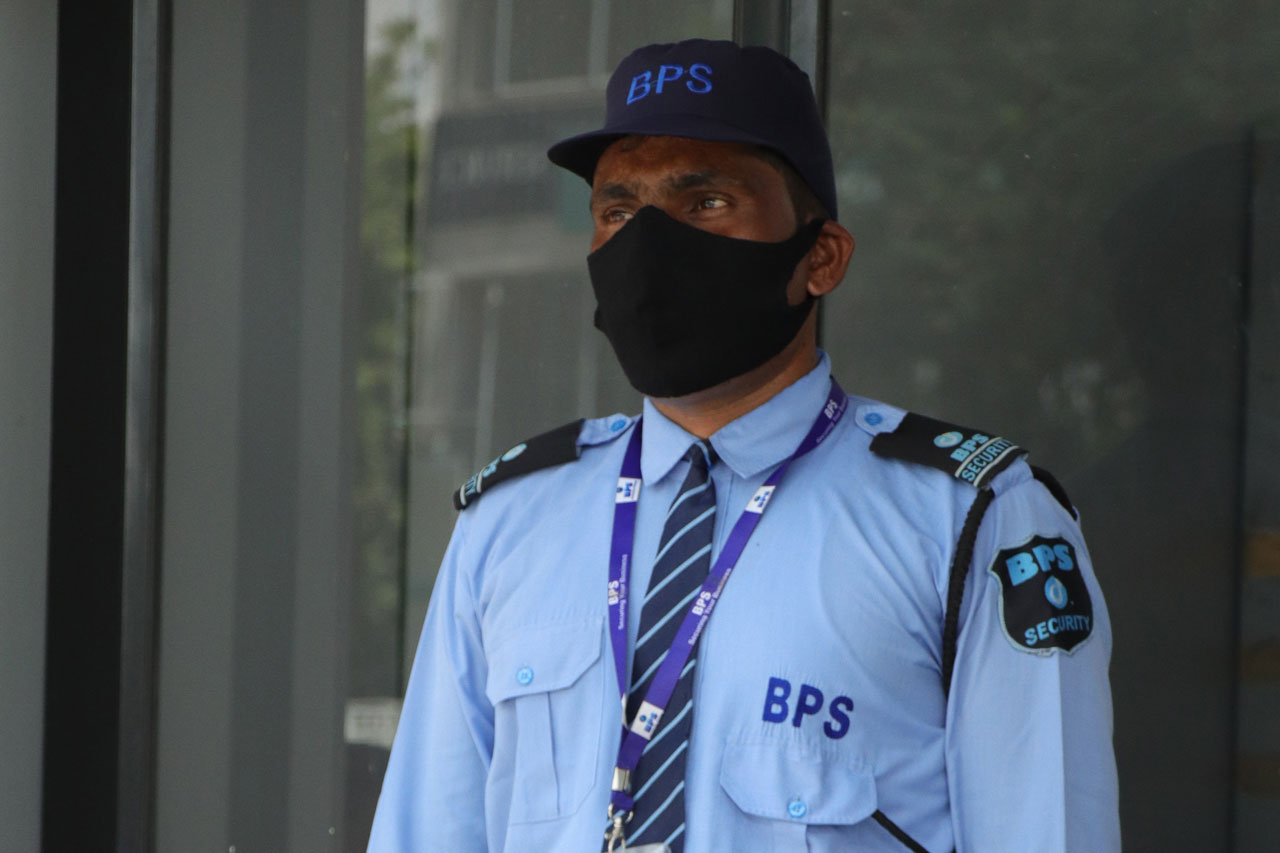 on duty security guard with facemask